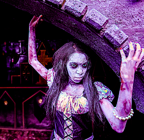 girl zombie leaning against wall in the haunted graveayrd