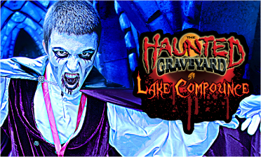 Blue lit vampire ready to pounce with Haunted Graveyard Logo