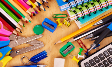 School supplies on desk background