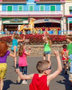 Excited kids running with hands up at the main gate