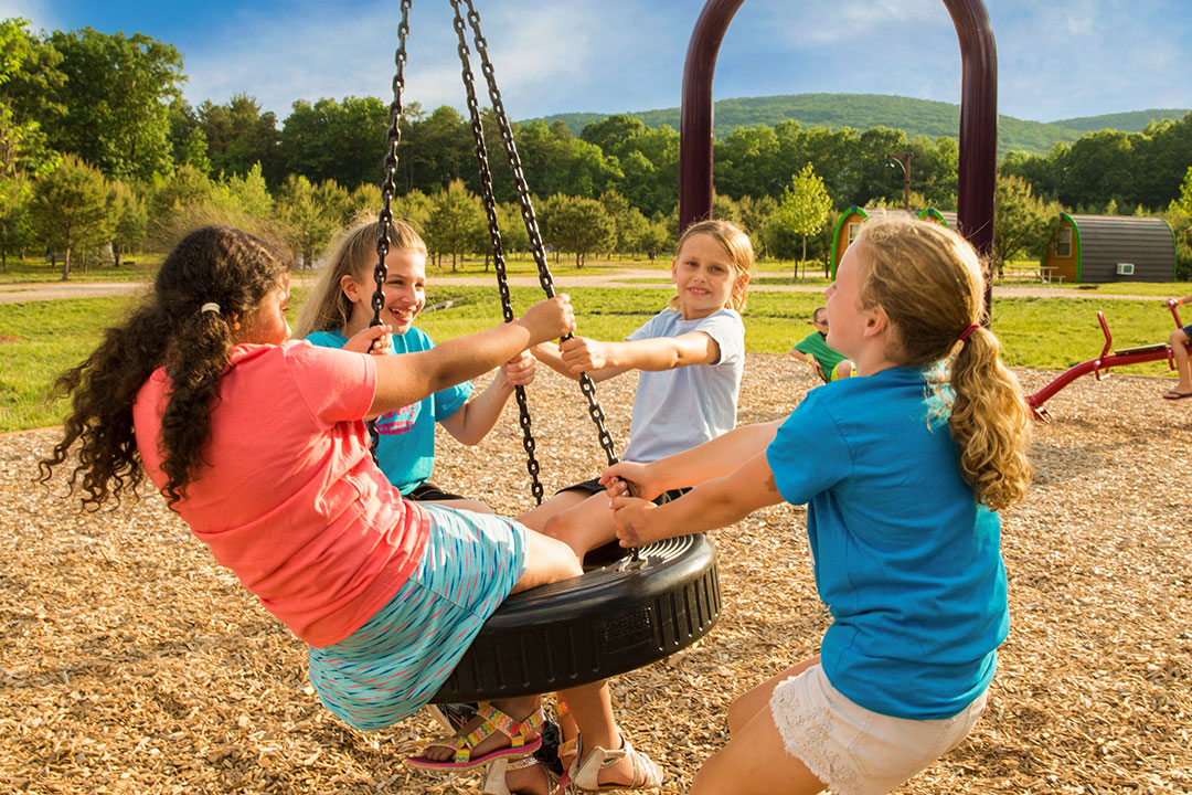 Group of girls on tire swing