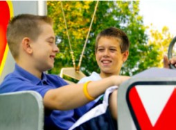Two boys on American Flyer ride