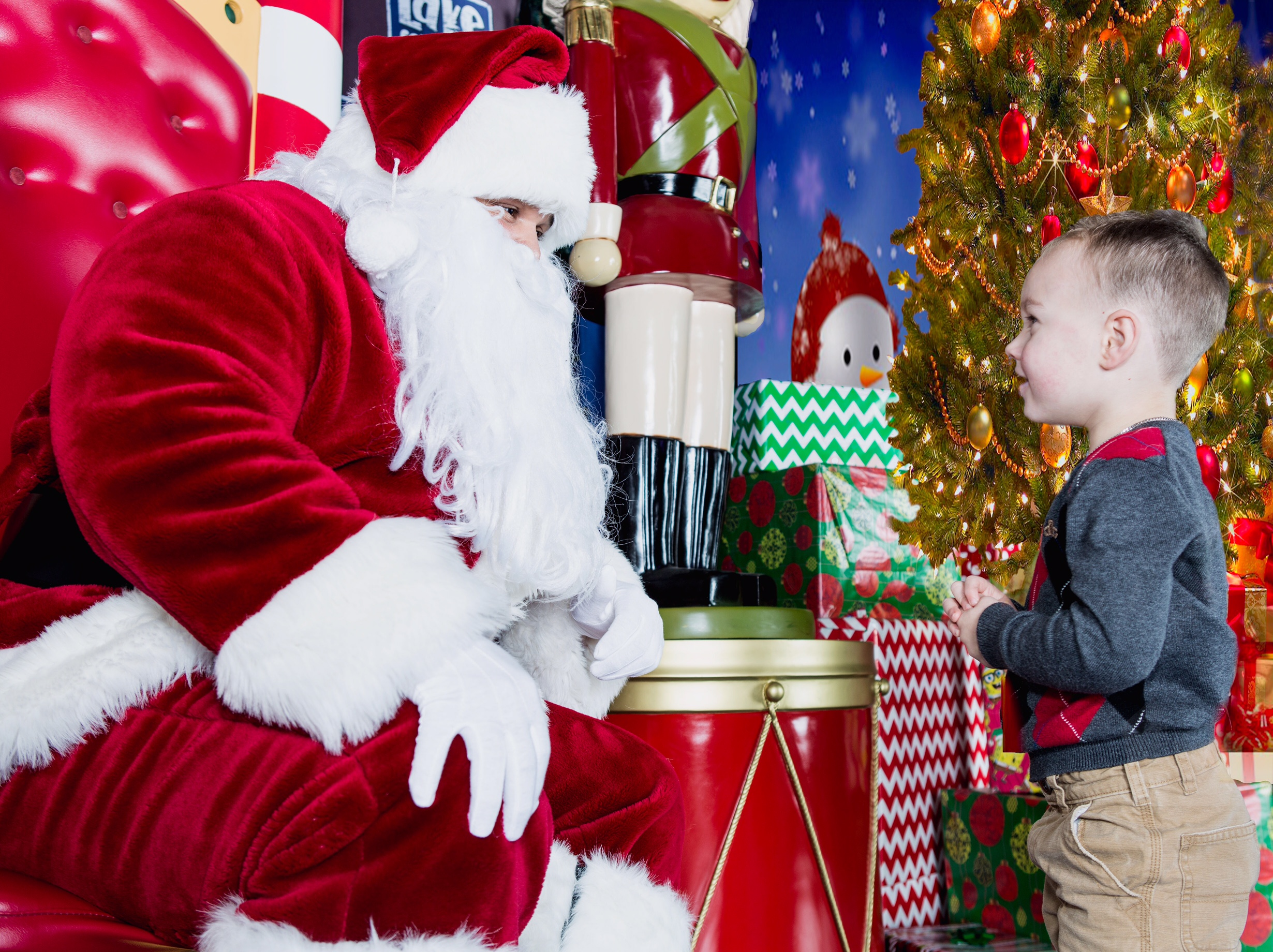 young boy talking with santa claus